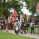 A procession walks through the grounds of Kentwell Hall Picture: SARAH LUCY BROWN