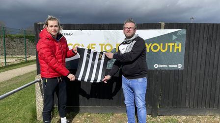 Todd Cantwell and Andrew Wright, vice-chair of Dereham Town Youth FC, with the kit donated from 4Sports