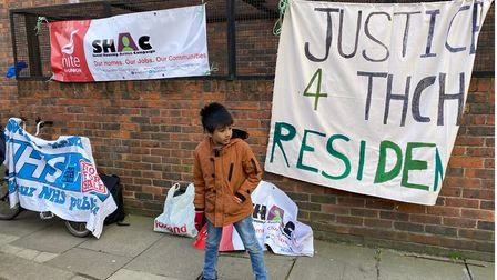 Helping to make the point... one youngster joins protesters in Watney Market