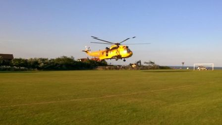 A helicopter is called to assist with the rescue of a boy from the sea near Corton. Picture: HM Lowe