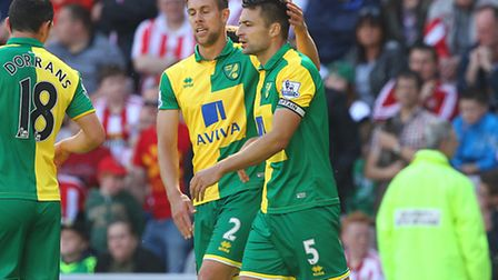 Norwich City's defensive duo Steven Whittaker and Russell Martin have been called into Scotland's sq