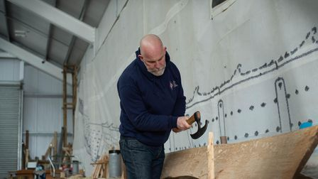 Trustee Simon Steel with the hand made traditional tool that are being used to build the Sutton Hoo