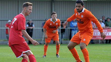 Action from an early-season FA Cup tie between Wisbech Town, red, and Diss Town. Picture: STEVE WILL