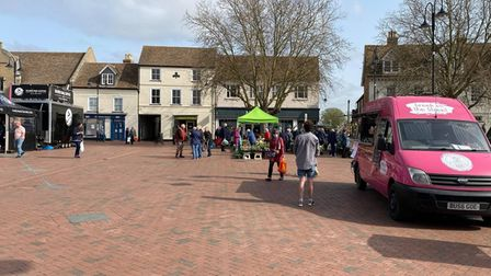 Shoppers browsing Ely Market on April 1