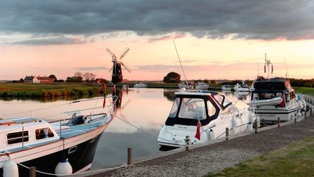 Norfolk Is... The evening light touches the moored boats at the Berney Arms windmill and sums up eve