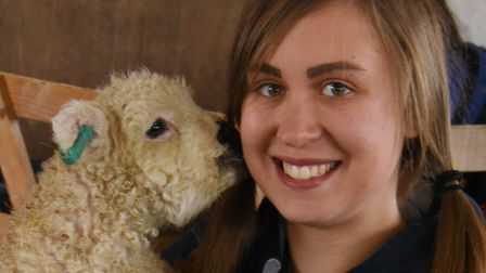 Rebecca Burnham livestock assistant manager at Church Farm inStow Bardolph, withtwo-week-old orphan lamb Kyle