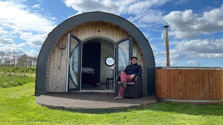 Luke Paterson with one of the luxury glamping pods at Tonnage Bridge, near Dilham Canal