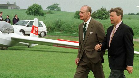 The British Glider Association's Paul Rice guides the Duke of Edinburgh on a tour in 1998