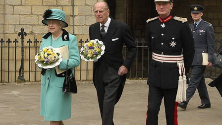 The Queen, Prince Philip and Lord Tollemache leave St Edmundsbury Cathedral in 2009