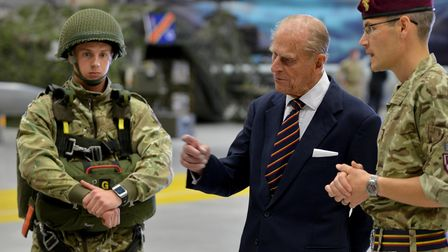 Image of HRH Prince Phillip being informed about the equipment being used by a REME craftsman from M