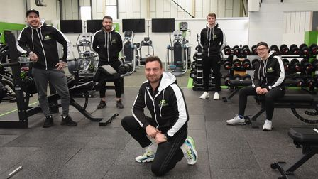 Nathan Gostling, front, with his team of managers in his latest New Revolution (NR) gym, which is at