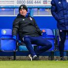 Town manager Paul Cook looks frustrated after another early free kick goes the way of the visitors.