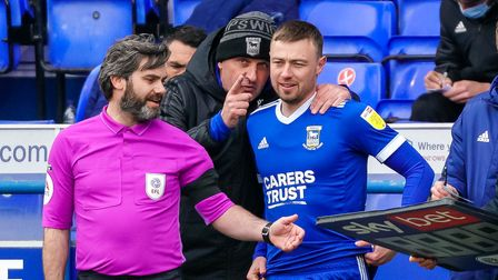 Town manager Paul Cook gives instructions to Freddie Sears ahead bringing him on in the second half.