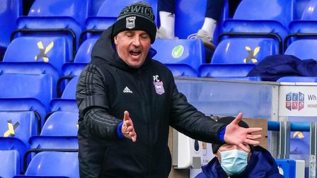 Town manager Paul Cook reacting on the touchline.