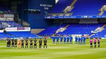 Players and officials observe a two minutes silence for Prince Philip ahead of the game.