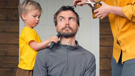 Family haircut at home during quarantine lockdown when closed all hairdressers. Mother cutting hair