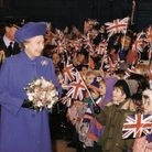 The Queen arrives at RAF Marham and is welcomed by local school children. Date 24 Jan 1996