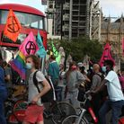 Extinction Rebellion protesters in Parliament Square, London, behind a police cordon blocking the Sq