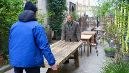 Getting beer garden ready at The George Tavern where 17th century cobblestone streethasbeen uncovered