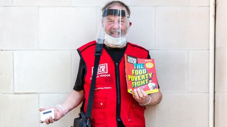 Vendor Mike Danks with protective face cover and contactless card payment device