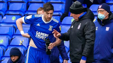 Town manager Paul Cook gives instructions to Stephen Ward during a break in play.