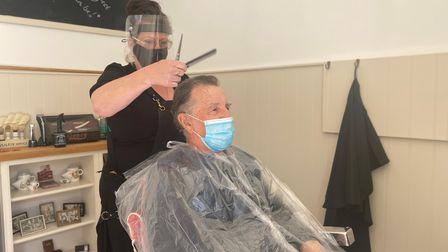 Jane Berry cutting her fathers hair in her new shop on Church Street, Dereham