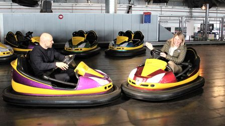 Catherine Southon and Serhat Ahmet, from the BBC's Antiques Road Trip, sat in the dodgems at Clacton Pier