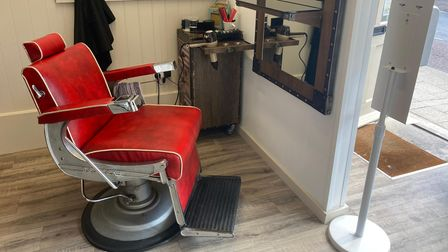 The shop has a retrobarbering chair complete with an armrest ashtray