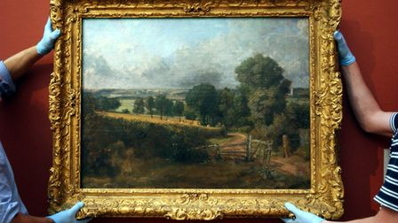 Handlers hang 'Fen Lane, East Bergholt' (1817) by John Constable at Tate Britain in central London.