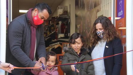 Keely Blows and Curtis Irish, Teddy, and Marlowe, cutting the ribbon of the Royston EACH charity shop on April 12, 2021.