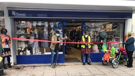 Norfolk entertainer Ben Langley (left) and Burston resident Pat opening the Mind charity shop in Diss on April 12, 2021.