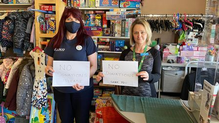 Lorraine Curston (right), founder of Sprowston-based Dawn's New Horizon, in its charity shop on Cannerby Lane.