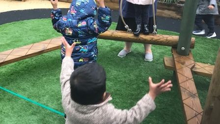 Toddlers getting outdoor play area at Manorfield School