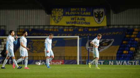 Dejected Town players leave the pitch after a 3-0 defeat against AFC Wimbledon