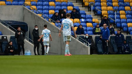 Josh Harrop consults the fourth official after being sent off for a very late challenge during the g
