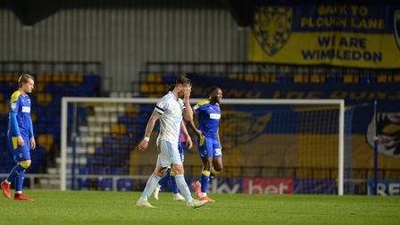 Luke Chambers runs his hands over his face after defeat against AFC Wimbledon