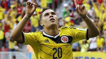 Colombia's Juan Quintero, left, celebrates after scoring his side's second goal against Ivory Coast'