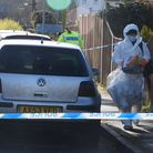 Police forensic officers at the scene of a fatal stabbing and three other people injured at Primrose
