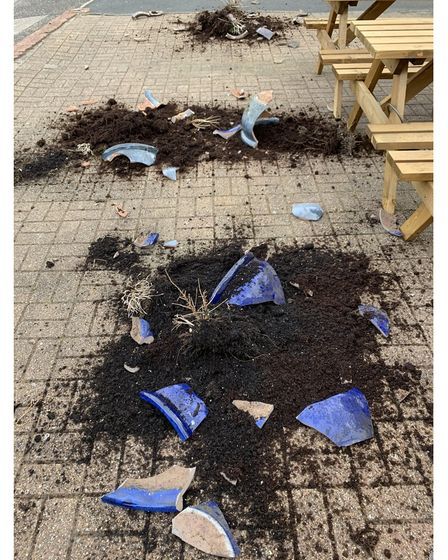 The broken plant pots on the ground outside Norski Noo's in Dereham