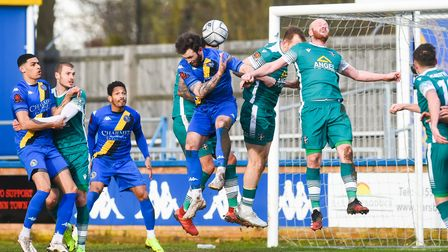King's Lynn Town defender Kyle Callan-McFadden causing havoc in the Sutton United penalty area on Sa
