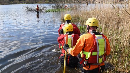 New Fire and Rescue recruits wade out to rescue victims of a kayak accident during their water rescu