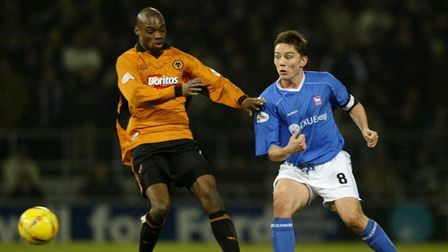 Ipswich Town's Matt Holland gets his pass past Wolves' George Ndah (left) during the Nationwide Div