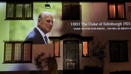 Photographic memories of the late Prince Philip are being projected onto a home in Barton Road, Ely