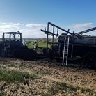 Firefighters put out the tractor on Mersea Island, Essex
