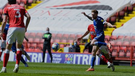 Teddy Bishop leaps over a challenge at Charlton Athletic