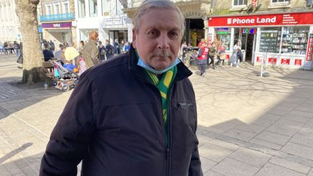 Norwich City fan Albert White wearing his Canaries scarf in the city centre