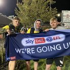 Norwich City fans hold up a banner saying 'We're Going Up'