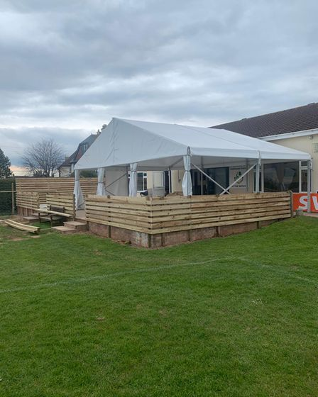 Marquee and patio in the clubhouse corner
