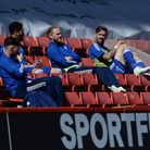 Luke Chambers soaks up the sun in the stands as an unused sub during the second half at Charlton Ath