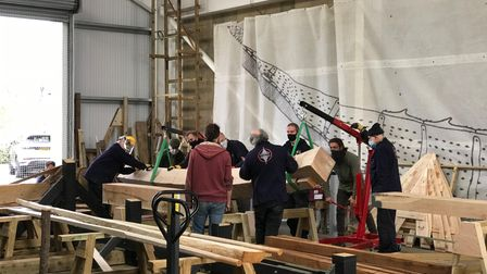 The keel was carefully placed in The Longshed, so volunteers can start to build the replica.